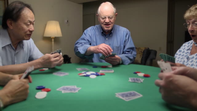 Senior Man Wins at Card Game
