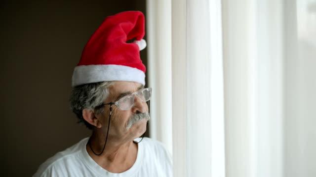 Senior man with Santa Claus hat video