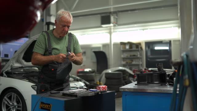 Senior man working in auto repair shop
