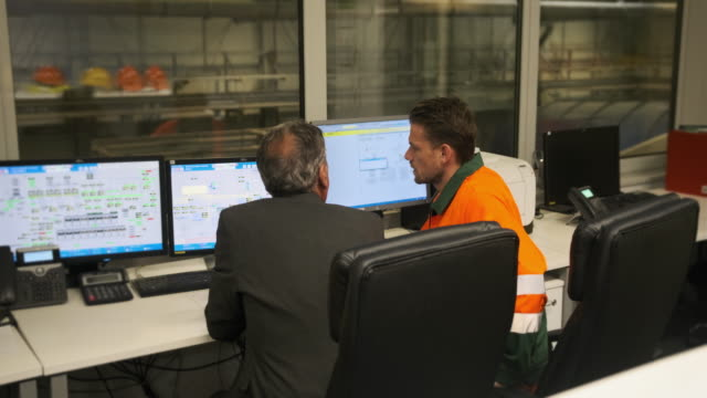 Senior Manager Observing Workers in Recycling Control Room video