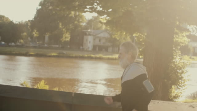 Senior marathon runner (slow motion) video