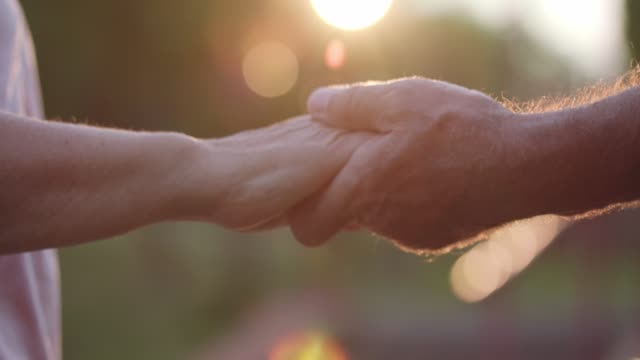 senior marred couple having a loving moment and holding hands - anniversario video stock e b–roll