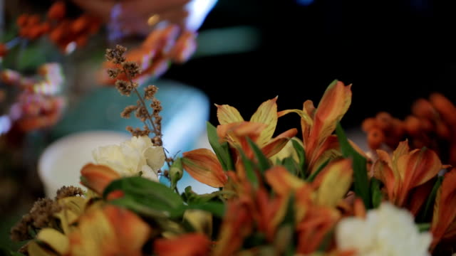 Senior Master expert florist working with flowers, bouquets, boutonnieres, herbs, plants video