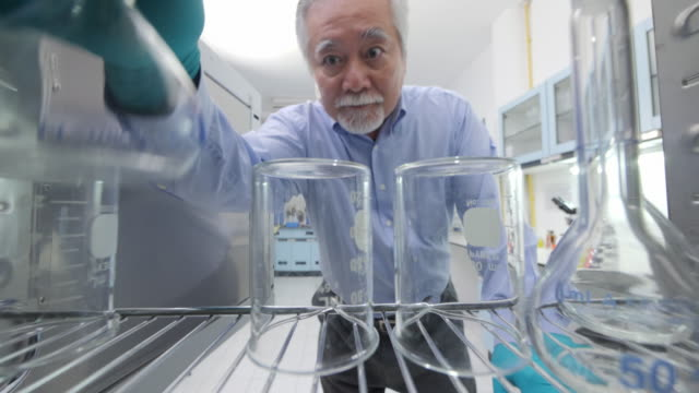 pov of senior medical research scientists taking instruments from the sterilisation machine - autoclave video stock e b–roll