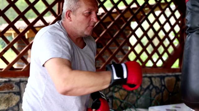 Senior men Boxing training outdoors video
