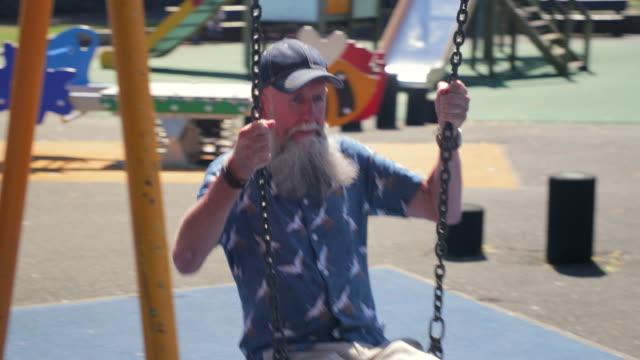 senior men enjoying their freedom - oscillare video stock e b–roll