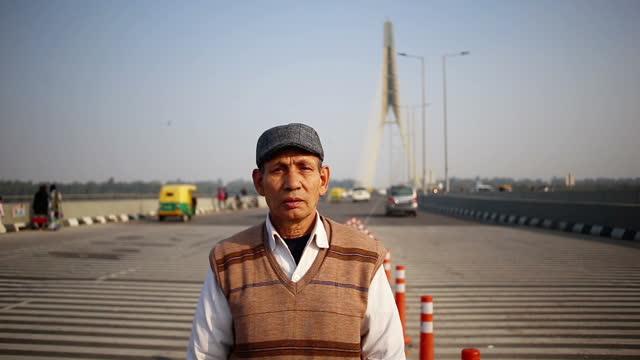 Senior men standing near signature bridge video