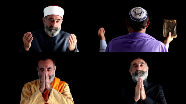 Senior muslim, christian,jewish and buddhist men praying video