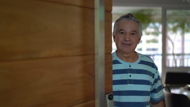 Senior Opening His Front Door Welcome to my house front door stock videos & royalty-free footage