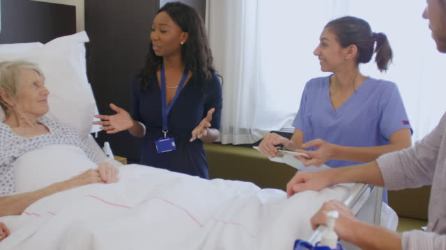 Senior Patient And Medical Staff In Consultation At Hospital video