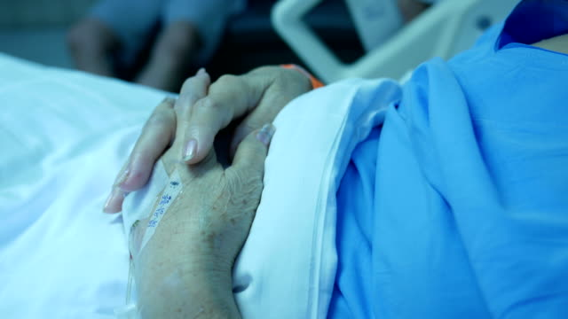 senior patient's hand resting on bed , saline senior patient's hand resting on bed , saline nhs stock videos & royalty-free footage
