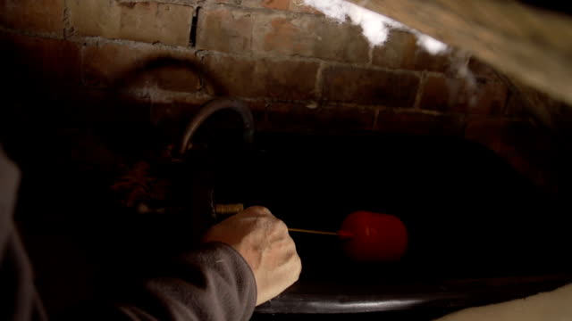Senior Pensioner Fixing Water Tank In Attic Of Old House video