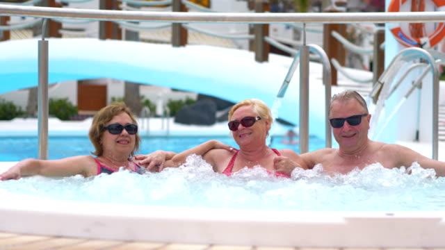 Senior people in the Hot Tub in 4k slow motion 60fps