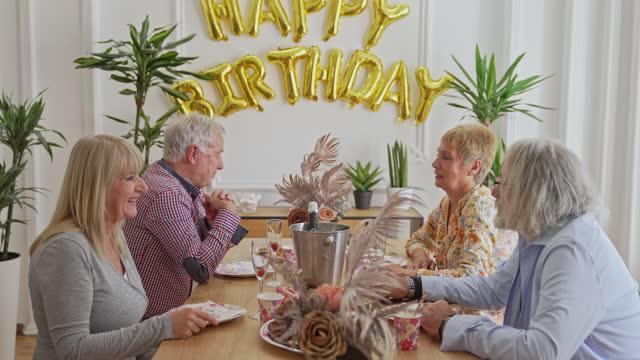 Senior people on birthday party video