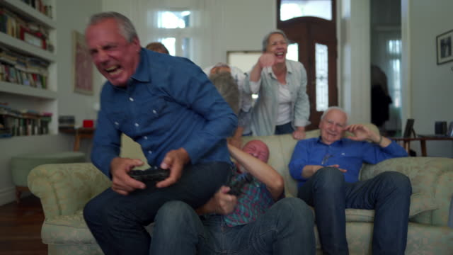 Senior people playing video games together in the nursing home