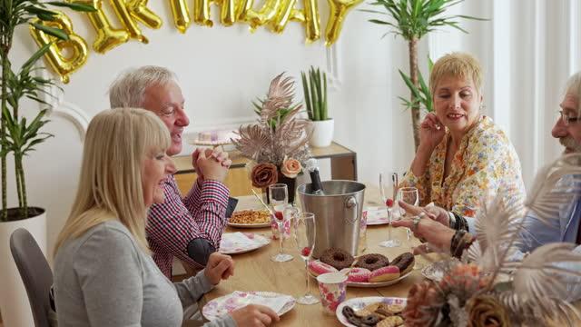 Senior people sitting on birthday party video