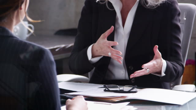 Senior professional woman gesturing at a meeting Senior professional woman gesturing at a meeting job interview stock videos & royalty-free footage