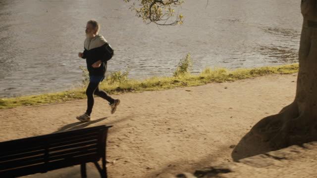 Senior runner in Melbourne park (slow motion) video