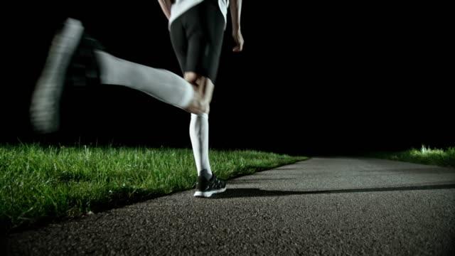 SLO MO PAN Senior runner running at night video