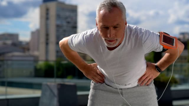 Senior sportry man doing stretching exercises video