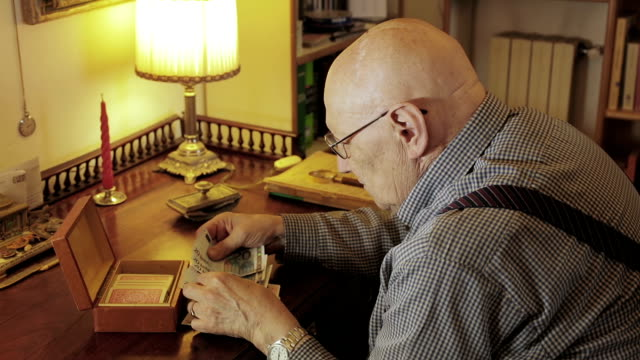 senior troubled man is counting his little savings: money, poor, hardship, aged video