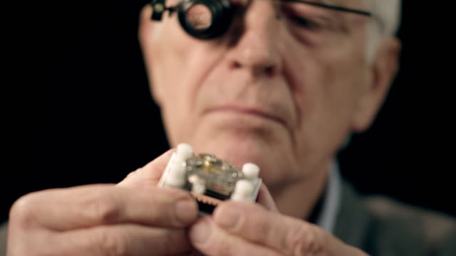 Senior watchmaker assembling watch Selected Takes - Shot on RED Epic accuracy stock videos & royalty-free footage