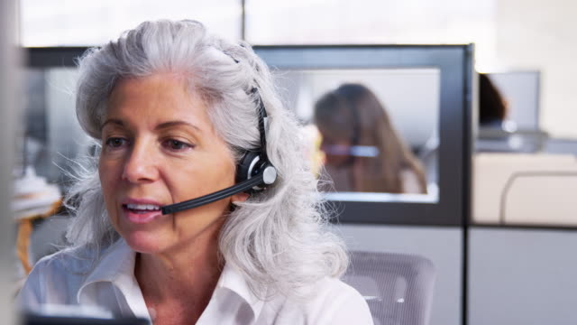 Senior white women working in a customer service call centre