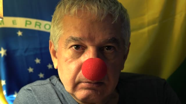 Senior with clown face with reference to Brazilian corruption