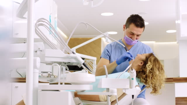 senior woman at dental office - dentist stock videos & royalty-free footage