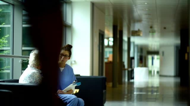 senior woman crying in  a hospital corridor video