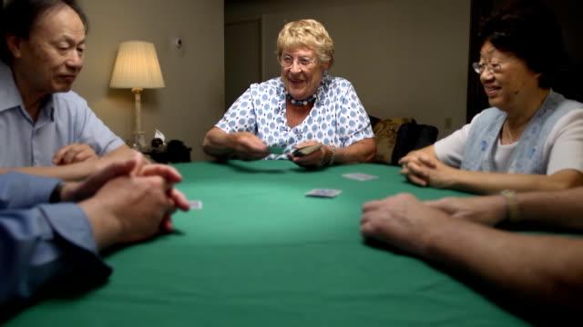 Senior Woman Deals Cards