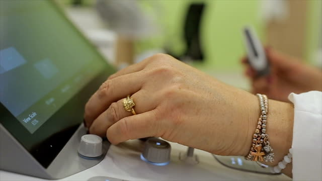 senior woman doctor works on modern ultrasound device,b roll video