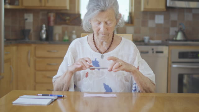 Senior Woman does Online Banking video