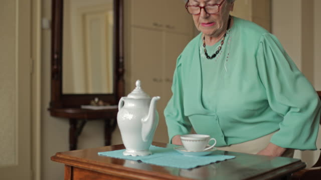 Senior woman drinking tea enjoying in relaxing day at home. video
