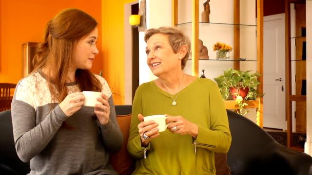 Senior Woman Drinks Tea with Friend video