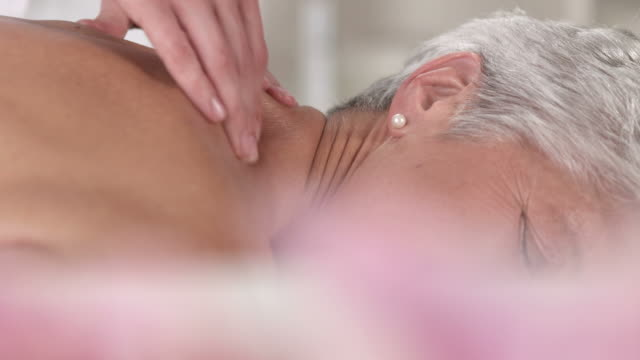 hd dolly: senior woman enjoying back massage - naturopathy stock videos and b-roll footage
