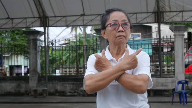 senior woman exercise Tai-Chi dance at car park video