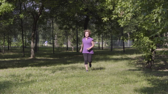 Senior woman exercising in the park video