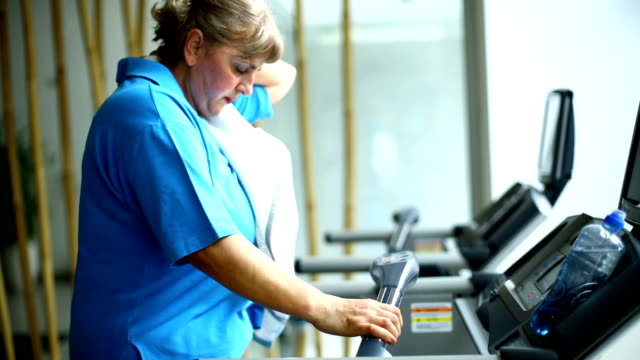 Senior woman exercising on a treadmill. video
