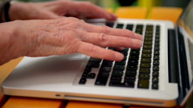 Senior woman hands typing video
