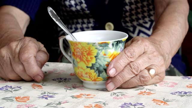 senior woman hands with a cup of tea closeup - tea cup stock videos & royalty-free footage