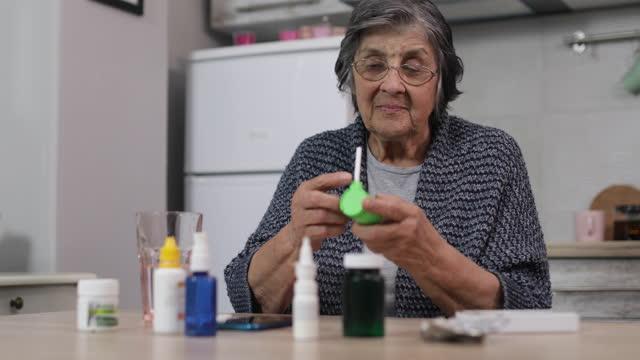 Senior woman having daily medicines at home