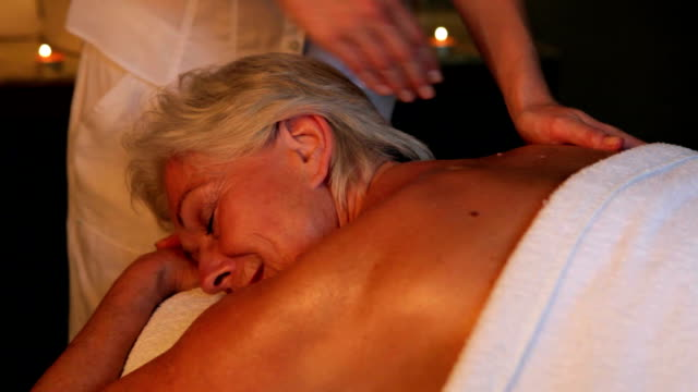 Senior Woman Having Massage In Spa Senior woman relaxing with massage at beauty spa.Shot on Canon 5d Mk2 with a frame rate of 30fps spa treatment stock videos & royalty-free footage