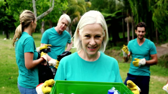 Senior woman holding a recycle bin video