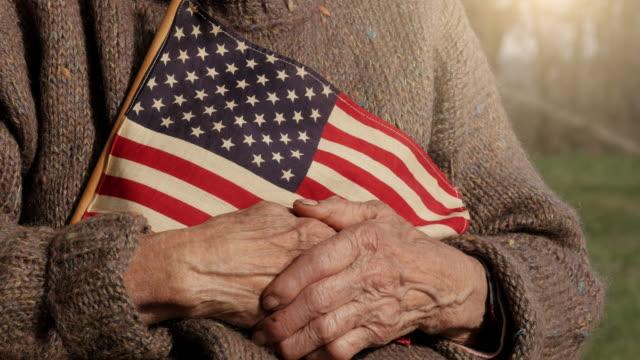 Senior Woman Holding American Flag video