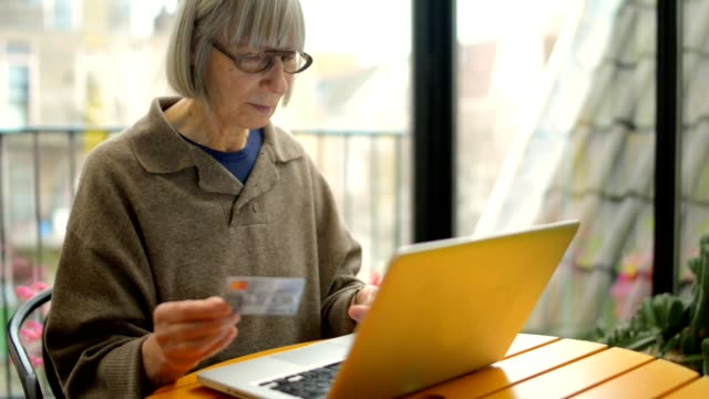 Senior woman home shopping video
