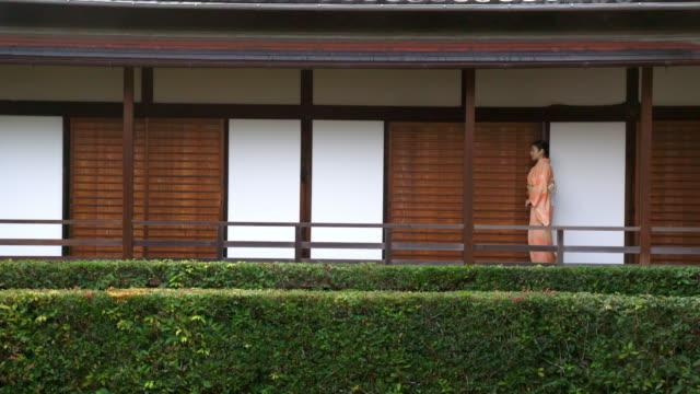Senior woman in a Kimono walking video