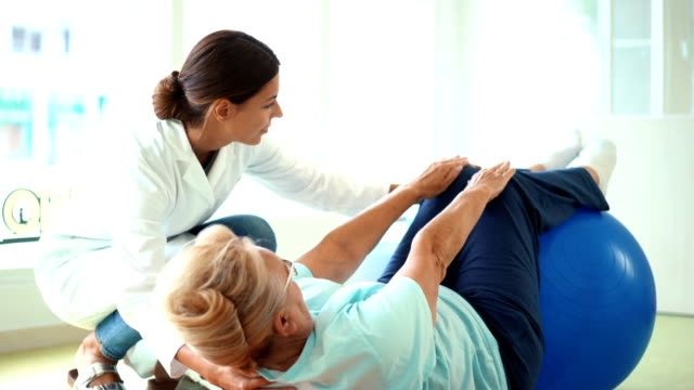 senior woman in physical rehab. - fisioterapia video stock e b–roll