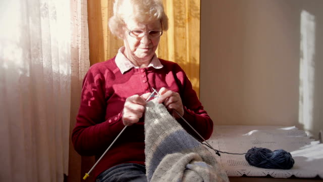 Senior woman knitting Senior woman knitting rocking chair stock videos & royalty-free footage