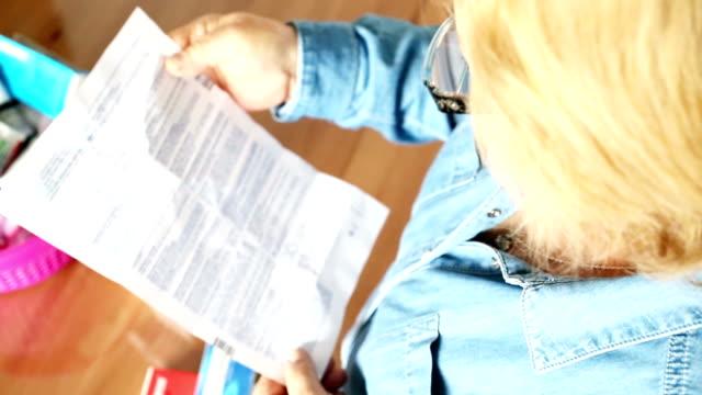 Senior woman looking medicines video